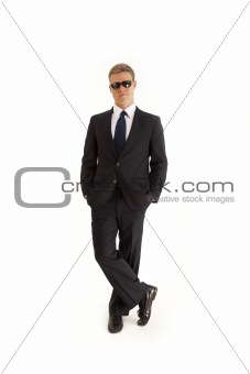 Portrait of serious young businessman wearing a suit and sunglasses