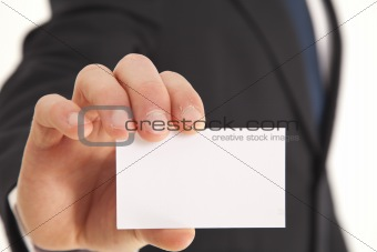 Portrait of businessman with a business card
