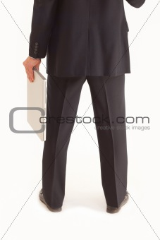 Back view of businessman holding laptop