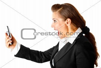 Amazed modern business woman yelling on cell phone
