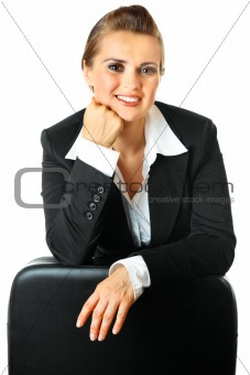Portrait of smiling modern business woman leaning  on chair
