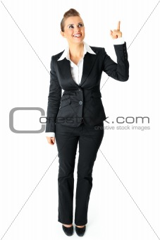 Full length portrait of smiling modern business woman pointing finger up