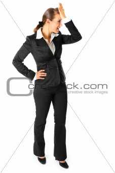 Solution is found! Full length portrait of  smiling modern business woman holding  hand at  forehead