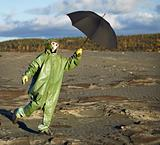 Person in protective scientific overalls with umbrella