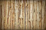 Wooden fence made of boards and slabs - background