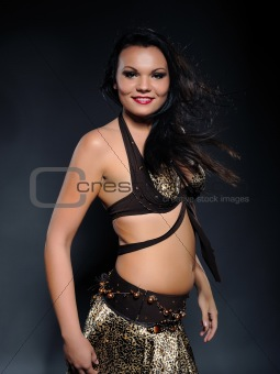 Beautiful sexy bellydancer woman with oriental make-up