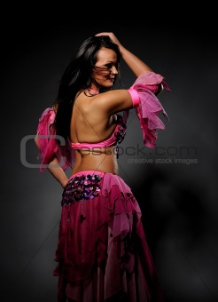 Beautiful sexy dancer woman in bellydance costume