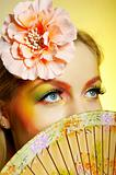 Close-up portrait of summer fashion creative eye make-up in yellow