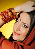 Young beautiful woman in indian traditional jewellary, bindi and