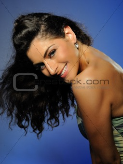 Beautiful smiling party girl with long curly hair