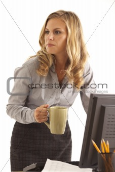 Businesswoman at desk with coffee