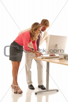 Business colleagues working at desk with computer