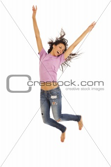 Cute young girl with jeans jumping energetically
