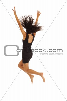 Cute young girl with black dress jumping energetically