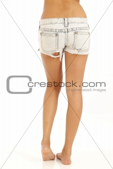 Back side of young sexy woman wearing jean shorts