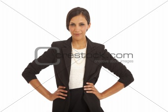 Portrait of confident young businesswoman with hands on hips