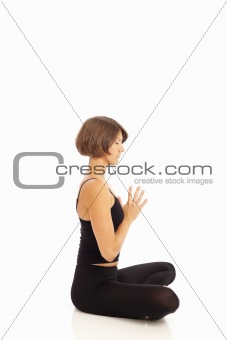 Young woman doing yoga Namaste Hands Pose