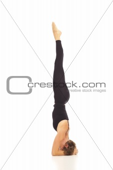 Young woman doing yoga Headstand Pose