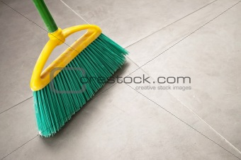Green plastic broom