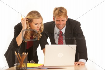 Business colleagues working at desk with laptop