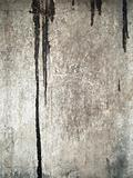 Black color drop on grunge old wall