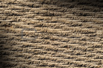 Grooved asphalt or rock surface texture  lit diagonally