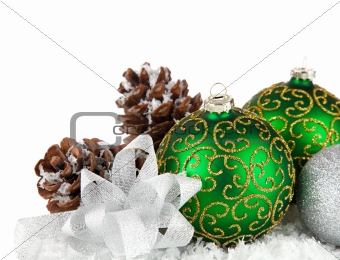 green balls in snow with gold bow