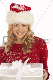 Woman in Santa hat holding present