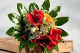 bouquet of flowers with roses in wooden box