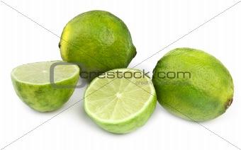 four lime fruit on white