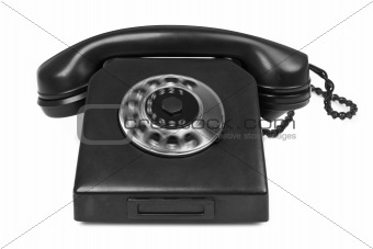 old bakelite telephone with spining dial on white