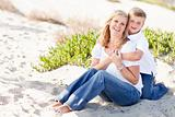 Cute Son Hugs His Attractive Mom Portrait at The Beach.