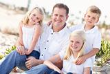 Handsome Dad and His Cute Children Portrait at The Beach.