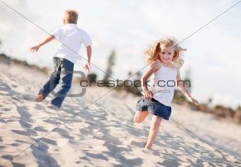 Adorable Brother and Sister Having Fun at the Beach One Sunny Afternoon.
