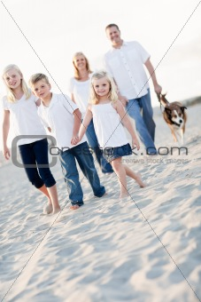 Adorable Little Girl Leads Her Family on a Walk at the Beach.