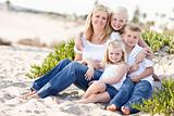 Attractive Mom Portrait with Her Cute Children at The Beach.