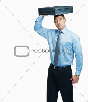 Business man with a briefcase over head and looking at copyspace