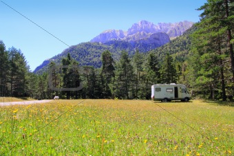 Camper autocaravan meadow in Pyrenees mountain
