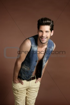 Handsome sexy young man portrait denim vest