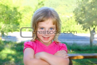 Blond little girl portratit happy smiling facing camera