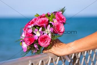 Beautiful wedding bouquet held by bride
