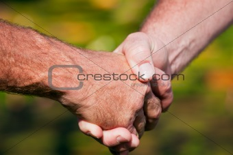 Firm handshake between two men