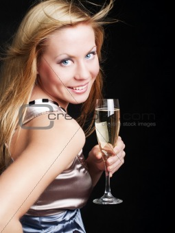 smiling young woman with sylvester champagne over dark 