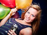 smiling woman holding new year&#39;s champagne and balloons