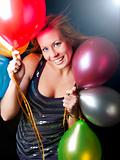 smiling woman on party holding ballons