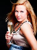 woman holding champagne over dark