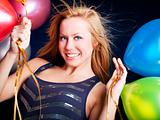 woman on party holding ballons