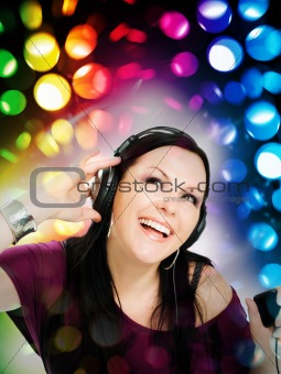 woman with headphones listening music by mp3