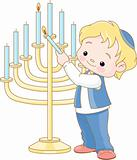 Jewish boy lighting Chanukah menorah
