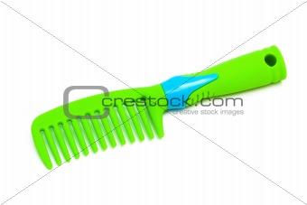 green plastic hairbrush